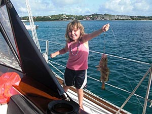 Madison catches a red hind fish!
