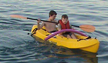 Two boys go kayaking